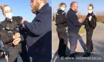 Outrage as police handcuff and ARREST man walking with his wife