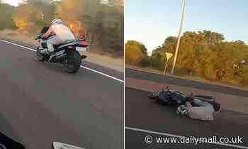 The video shows a motorcyclist doing over 200km/h before he suddenly brakes and crashes on the road