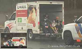 Six people, including two children, rescued from the back of a U-haul