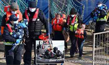 Small child with no shoes is among about 40 migrants to arrive at Dover in two boats today