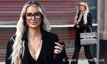 Olivia Attwood looks stylish in a plunging black blazer and a Chanel pearl necklace