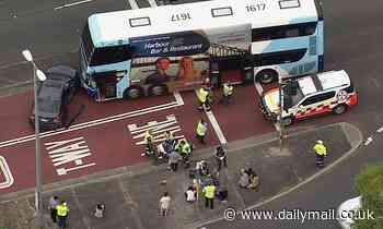 Double-decker bus smashes into a car during peak-hour traffic in Liverpool, Sydney