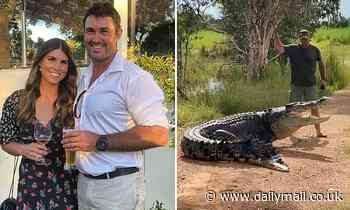 Incredible moment brave Aussie shoos a gigantic saltwater crocodile off a walking track