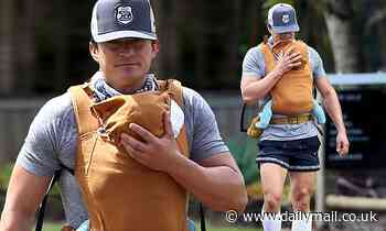 Orlando Bloom flaunts muscular arms and legs during stroll with daughter Daisy in Hawaii