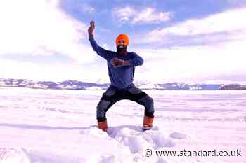 Yukon man shares delight in Covid vaccine by bhangra dancing on frozen lake in Canada