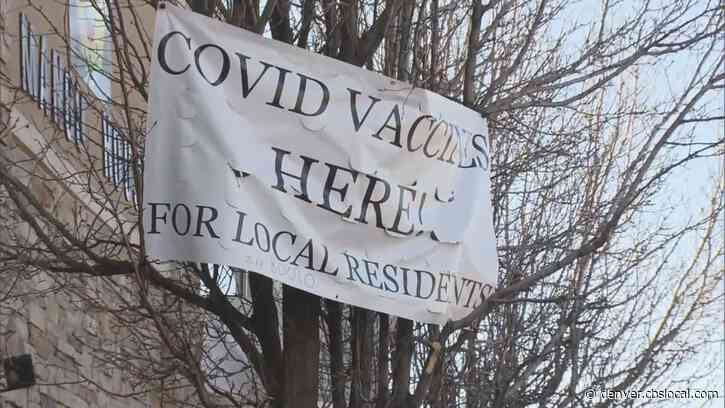 COVID In Aurora: Signs For Vaccine Become Sticking Point Between Clinic & City