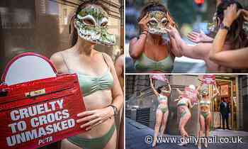 Bikini-clad activists dressed as crocodiles protest outside of designer store over animal skins