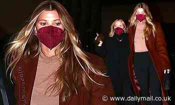 Sofia Richie cuts an elegant figure in a coat as steps out for dinner with glamorous pal