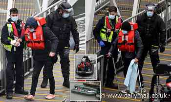 Injured and barefoot migrants arrive at Dover after crossing Channel in rubber dinghy