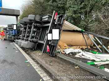 Delays as HGV overturns on motorway