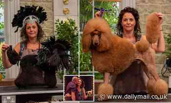 I'm top of the pups! Kelly nabs the Pooch Perfect trophy... with help from Cher lookalike