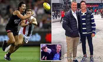 If looks could kill: Why WAG gave AFL legend a FILTHY look as they watched their son from the stands