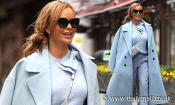 Amanda Holden looks effortlessly chic in a powder blue coat