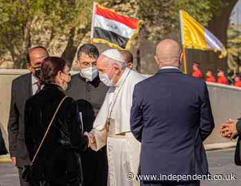 Pope Francis arrives in Iraq and calls for an end to divisions, amid huge security operation