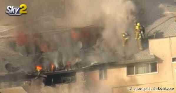 Crews Working To Extinguish Fire At Panorama City Condo Building