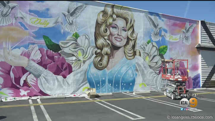 'She Represents Love And Light': Dolly Parton Mural On Wall Of Costa Mesa Bar Nearly Complete