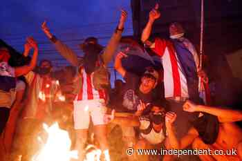 Protesters injured after police clashes over Paraguay's Covid response