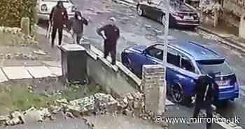 Horrifying moment gang of masked machete-wielding burglars raid family home