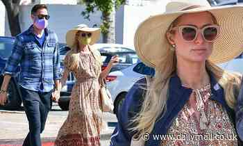 Paris Hilton goes shopping in a floral-print sundress with her fiancé Carter Reum