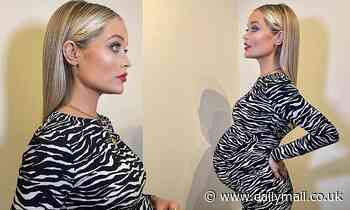 Pregnant Laura Whitmore displays her growing baby bump while filming for Celebrity Juice