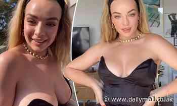 Abbie Chatfield narrowly avoids a wardrobe malfunction in a VERY low-cut top