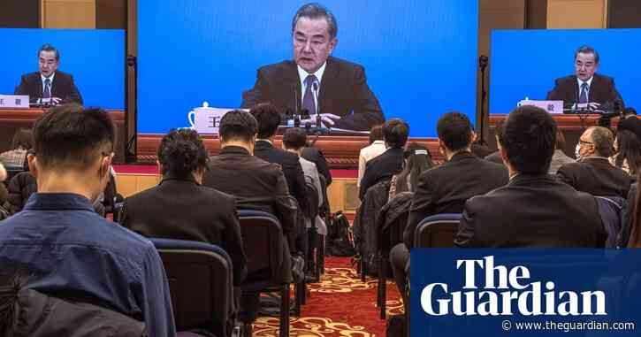 China calls on US to drop Trump-era sanctions and warns against 'bullying'