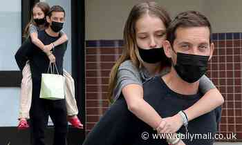 Tobey Maguire gives his 14-year-old daughter Ruby a piggyback ride in Beverly Hills