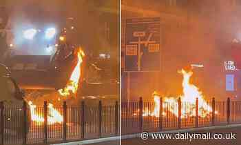 Bin lorry driver dumps burning load onto London street