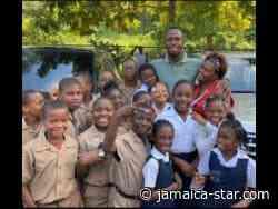 Usain Bolt donates 150 laptops to rural schools | News - Jamaica Star Online