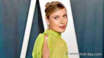 Maria Sharapova just loves to curl up with a good book - Mid-Day