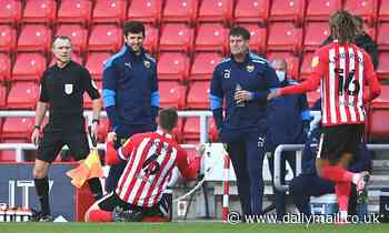 Sunderland's Max Power celebrates goal in front of Oxford dugout following mass half-time brawl