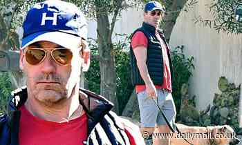 Jon Hamm enjoys the sunny Los Angeles weather in a set of shorts and sandals while walking his dog - Daily Mail