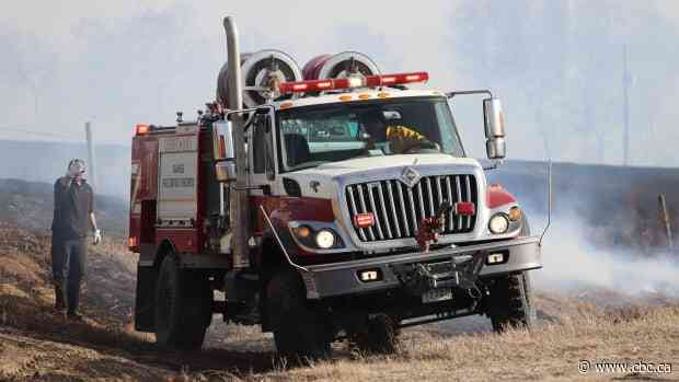 Large grass fire west of Carberry, Man., believed to have been started by ATV, fire department says - CBC.ca