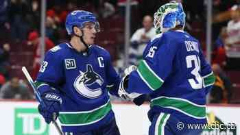 Canucks' COVID-19 troubles send chill through NHL's North Division