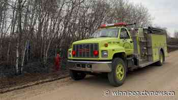 Crews continue to extinguish hotspots a day after large grassfire near Carberry - CTV News Winnipeg