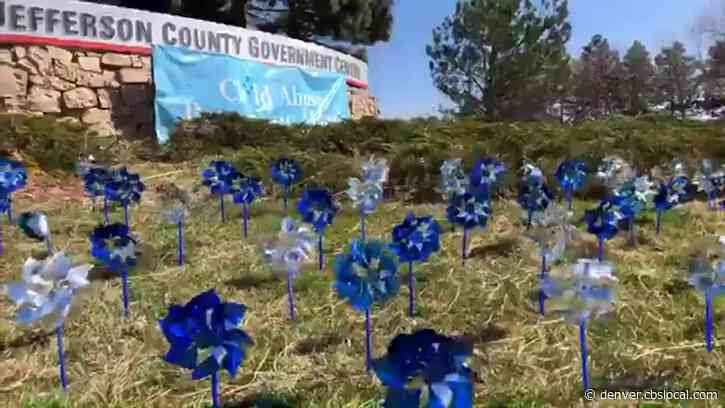 Blue And Silver Pinwheel Garden Is Reminder To Watch For Child Abuse