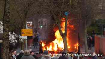 Police attacked and hijacked bus set alight as disorder breaks out in west Belfast