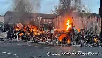 Bus set on fire and press photographer attacked as disorder resumes in Belfast