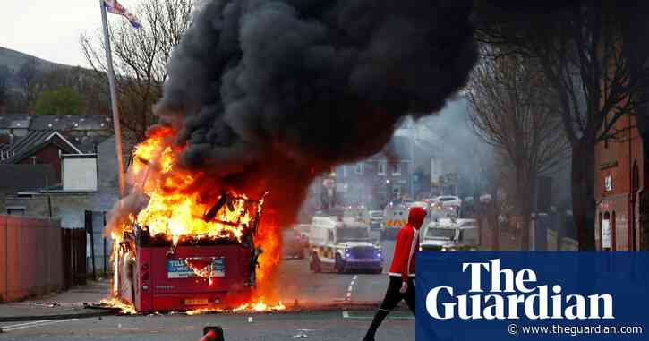 Protesters in Belfast hijack bus and set it on fire – video