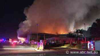Visy recycling factory burns in Adelaide's north