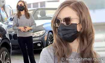 Lily Collins is effortlessly stylish as she stops at a gas station in West Hollywood - Daily Mail
