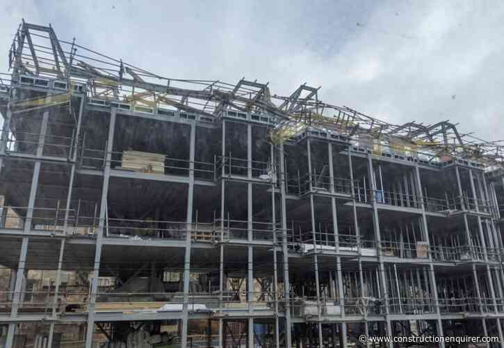 Scaffolding collapses on top floor of apartment site