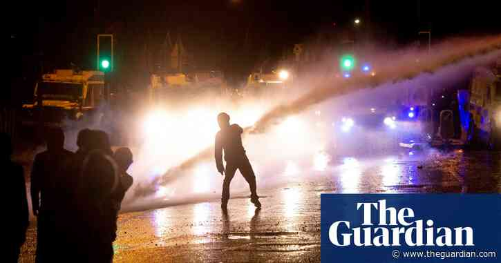 Belfast police use water cannon on Northern Ireland rioters – video