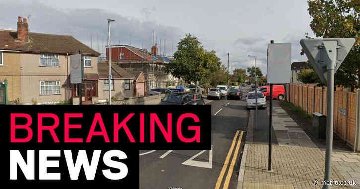 Woman in 50s fighting for her life after axe attack