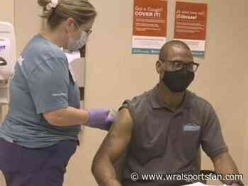 Panthers legend Mike Rucker receives COVID vaccine