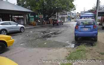 [Galería] Tierra Colorada, entre charcos y calles rotas - El Heraldo de Tabasco