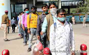Surge in migrant workers leaving Delhi as spectre of another lockdown looms over India