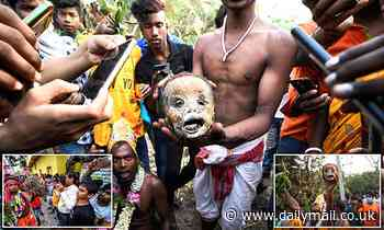 Worshippers dance with a human SKULL to appease Hindu deity in India