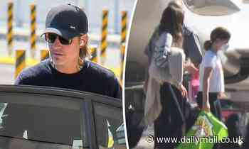 Keith Urban boards a private jet in Sydney with daughters Sunday, 12, and Faith, 10, - Daily Mail