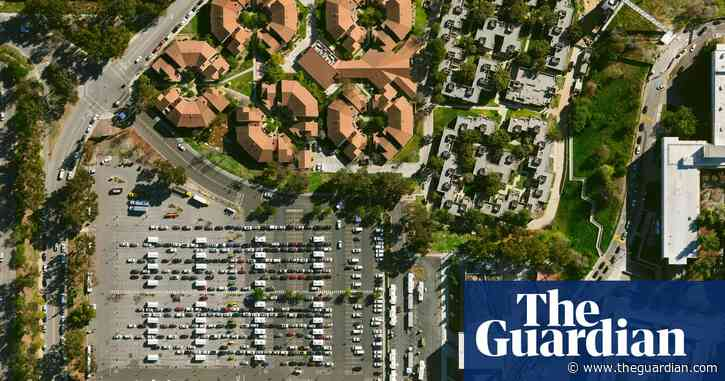 Ballparks, stadiums and race tracks: US mass vaccination sites – in pictures